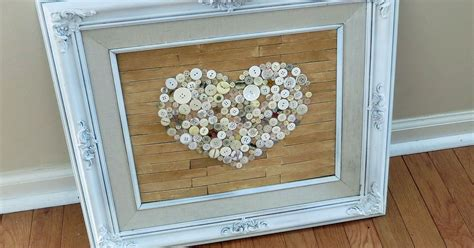 decor picture frame upcycle repurpose crafts home decor old frame repurposed with faux pallet button heart art