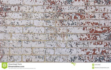 painted wall chipped red white grey blue paint brick wall stock photo