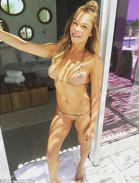 fine blonde bush leann rimes shows off flawless figure in tiny bikini