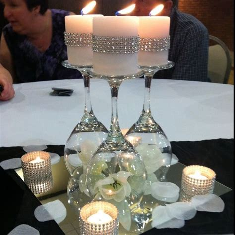 Impressive Diy Wine Glasses On A Mirror Wedding Table Wedding Candle Centerpieces On A Budget