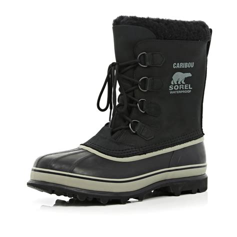 river island black sorel caribou waterproof boots in black