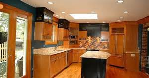 two toned cabinets in the kitchen or two toned corian in