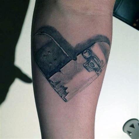 skateboarding tattoos shaped broken skateboard on forearm in