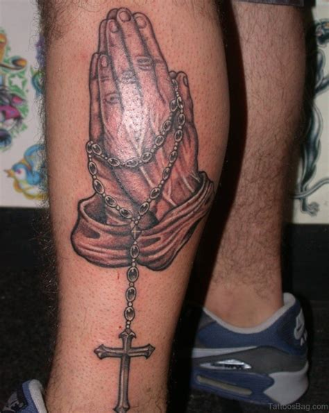 34 religious praying hands tattoos on leg