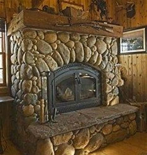 standout river rock fireplace designs all time