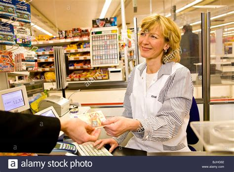 cashier in the supermarket stock photo royalty