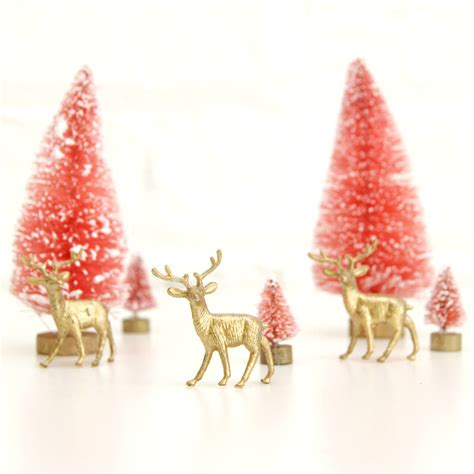 set of three gold reindeer christmas tree decorations by