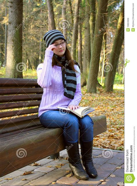 girl bench beautiful girl sitting on a bench royalty free stock