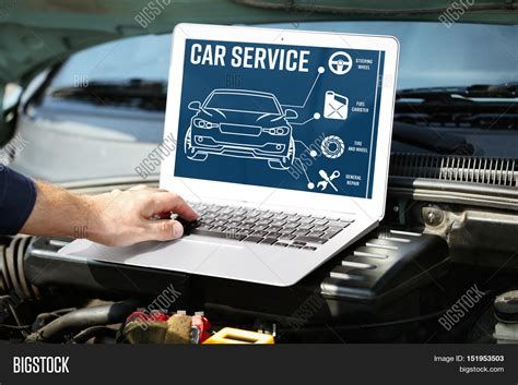 car service mechanic laptop near car engine image photo bigstock