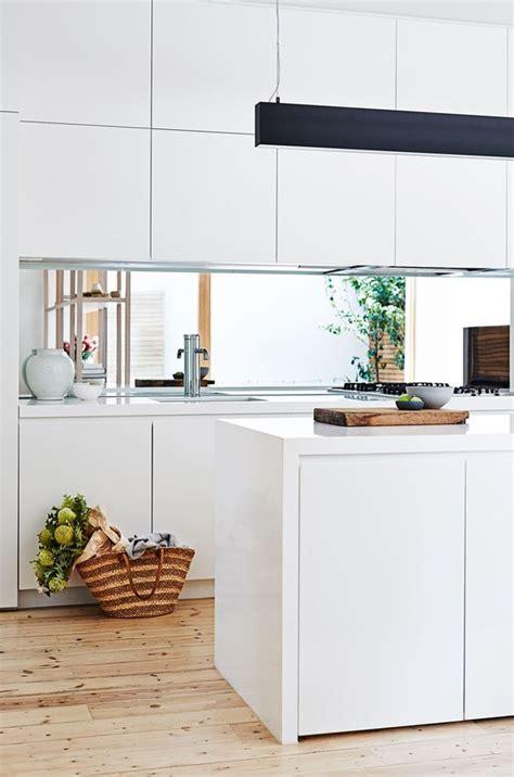 kitchen pendant lights and mirrored tile splashback home kitchen matt white handleless cabinets mirror splashback