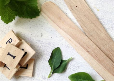 3 diy herb gardens you ll want to grow huffpost diy scrabble tile herb garden markers