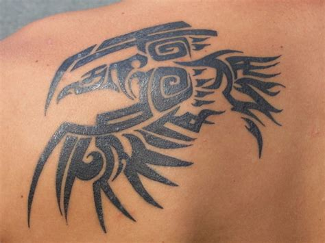 tribal raven tattoos looking for artist in the sacramento northern ca area that