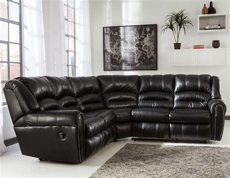 ashley furniture leather nailhead sofa signature design by ashley manzanola reclining sectional