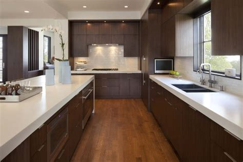 white kitchen cabinets with dark countertops i have dark kitchen cabinets with white countertops as