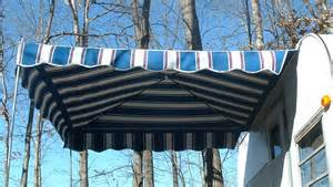 vintage awnings attract attention with a trailer vendor