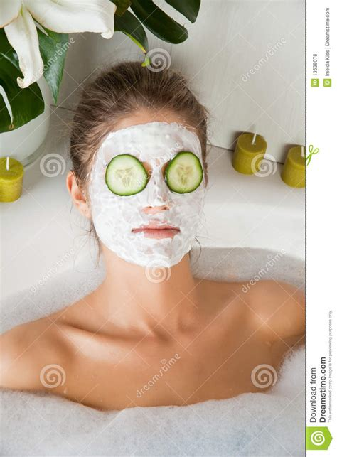 bathroom facial young beauty woman in the bath with face mask royalty free