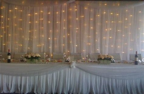 Tulle w/lights   thinking this for reception walls to