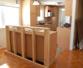 building a bar with kitchen cabinets kitchens with island bar the breakfast bar island under construction kitchen pinterest