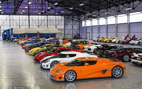 exotic cars lined up 163 20m worth of the world s fastest supercars brave rain for