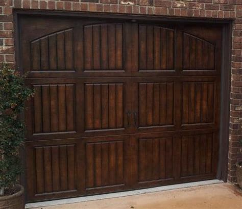 paint a metal garage door to look like wood everything i faux garage doors