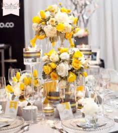 yellow and gray centerpieces yellow reception wedding flowers wedding decor yellow