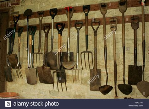 how to hang tools in shed rows of tools hanging up inside garden shed stock photo