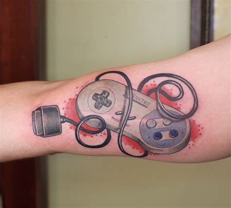nintendo controller tattoo inked wednesday 26 geeky tattoos by jeffrey meyer