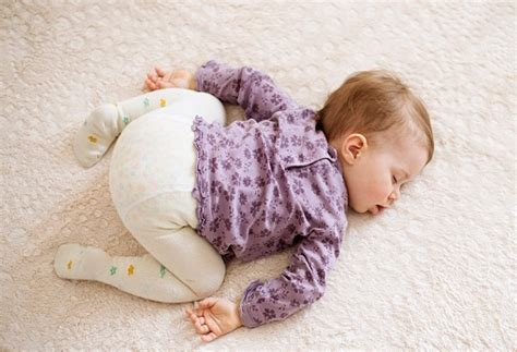 how to stop baby from rolling in cot baby rolling over in sleep new health advisor
