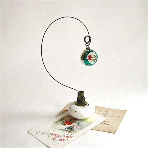 vintage doorknob photo holder with vintage christmas ornament