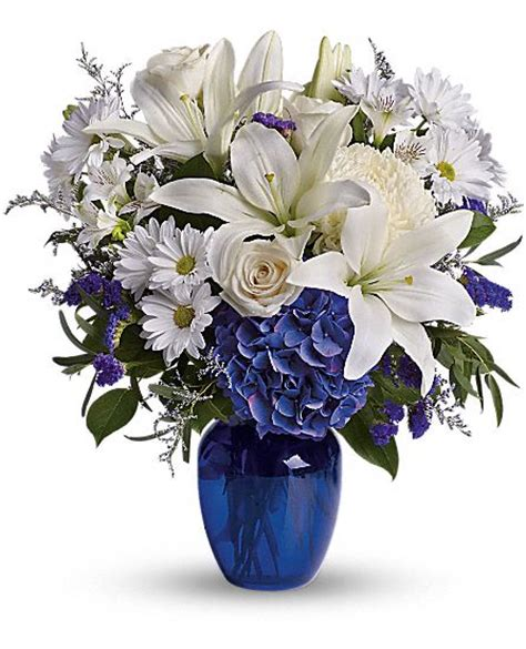 Arranging Roses In Vase Beautiful In Blue T209 3a Flower Delivery By Florist