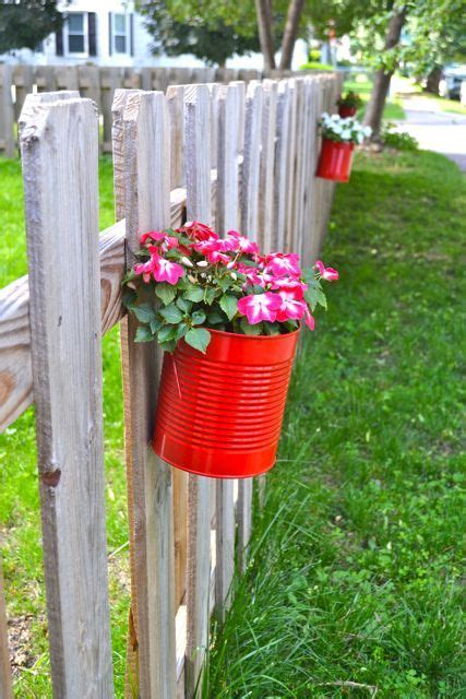 upcycling cans to diy hanging fence planters citronella