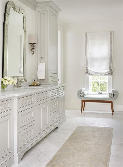 light grey bathroom cabinets with glass knobs