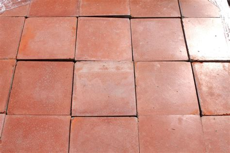 reclaimed 9 x 9 inch terracotta red quarry tiles