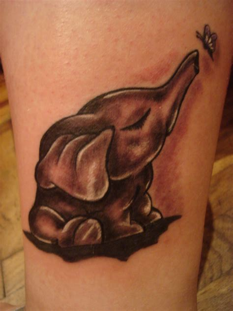 elephant tattoo with trunk up meaning elephant tattoos