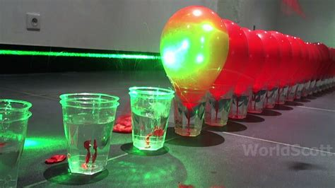 Laser Popping Balloons by World Record 100 Laser Balloon Popping Dom