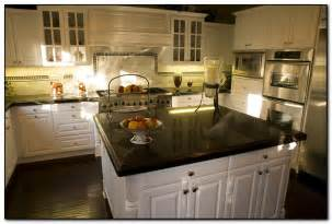 white kitchen cabinets with black granite countertops kitchen with black countertops for elegant design home
