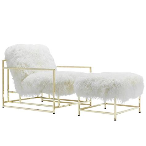 white armchair with ottoman white mongolian sheepskin and polished brass armchair and