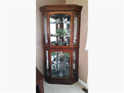 solid oak corner curio cabinet rural