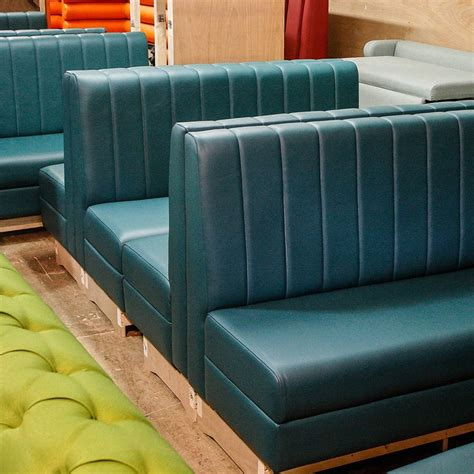 blue banquette back to back petrol blue fluted booth seating