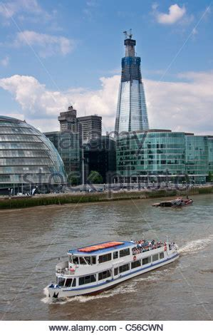thames river cruise shard tourist boat on river thames by st katharine pier by tower