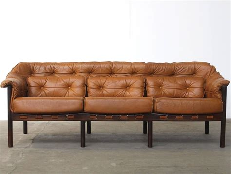 tufted leather camel colored  seat arne norell sofa