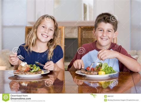 Extended Dining Table brother and sister eating meal mealtime together royalty