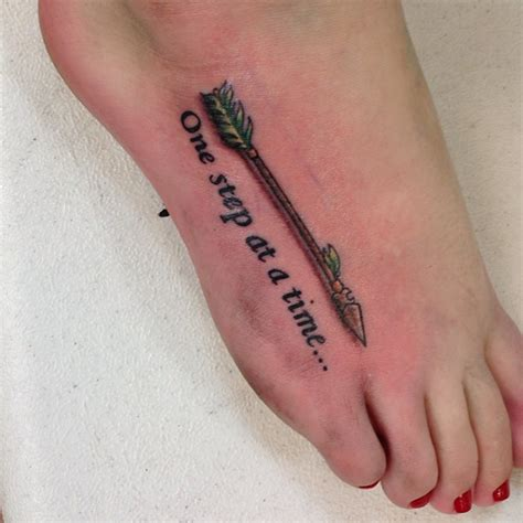one step at a time tattoo one step at a time arrow on foot tattooshunt