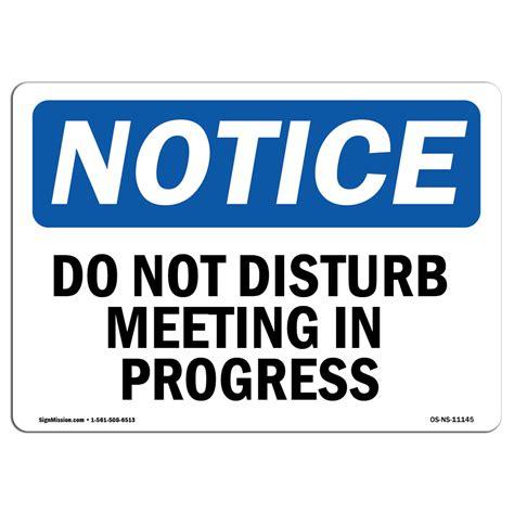 meeting in progress do not disturb no entry door notice hanging