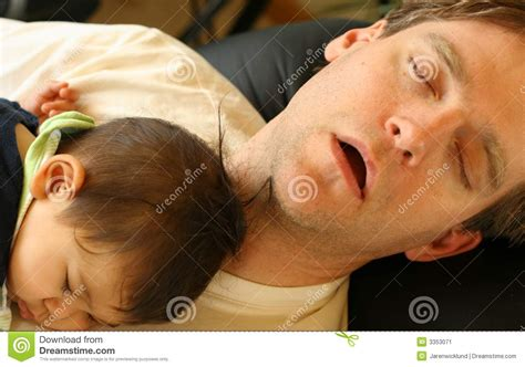 sleeping with baby in recliner baby sleeping on dad s chest stock image image 3353071