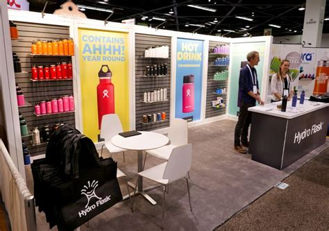 booth design maker simple slat wall and large colorful graphics help make