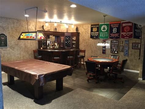 this archetypical 50 s rec room basement features the reffitt s basement man cave bar primo craft blaine minnesota