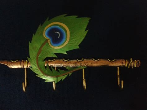 krishna flute with peacock feather painting