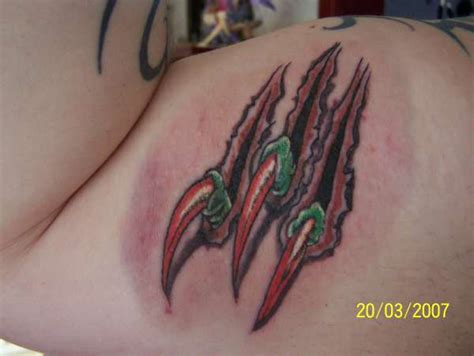 dragon claws tattoo