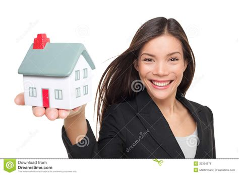 female real estate agents real estate agent selling home holding mini house royalty